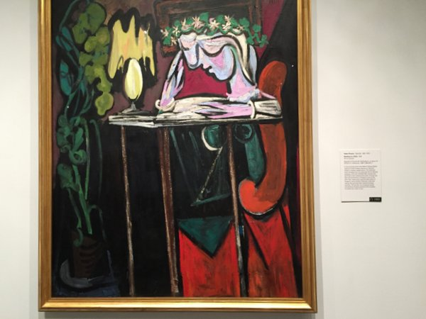 © Pablo Picasso... painting of his lover Marie, reading at a table with the lamp...